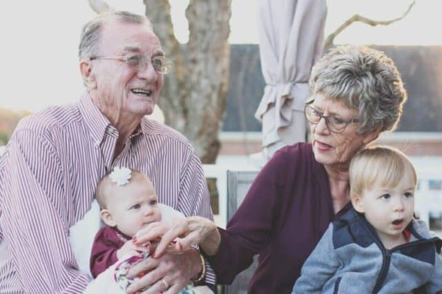 Effects of alcohol in pregnancy Grandmother and grandfather holding child on their lap