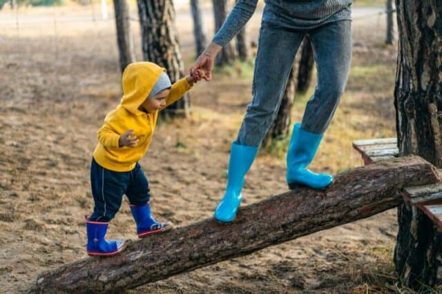 Benefits of exercise to children Kid walking on a branch