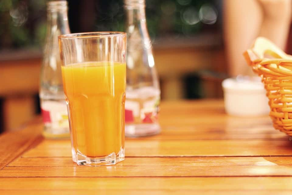 Why it is important to drink enough fluid Orange juice in a glass