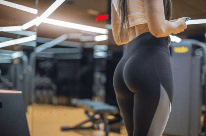 Woman in leggings facing her buttocks