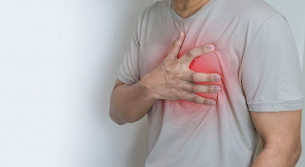 Man holding his chest, heart attack