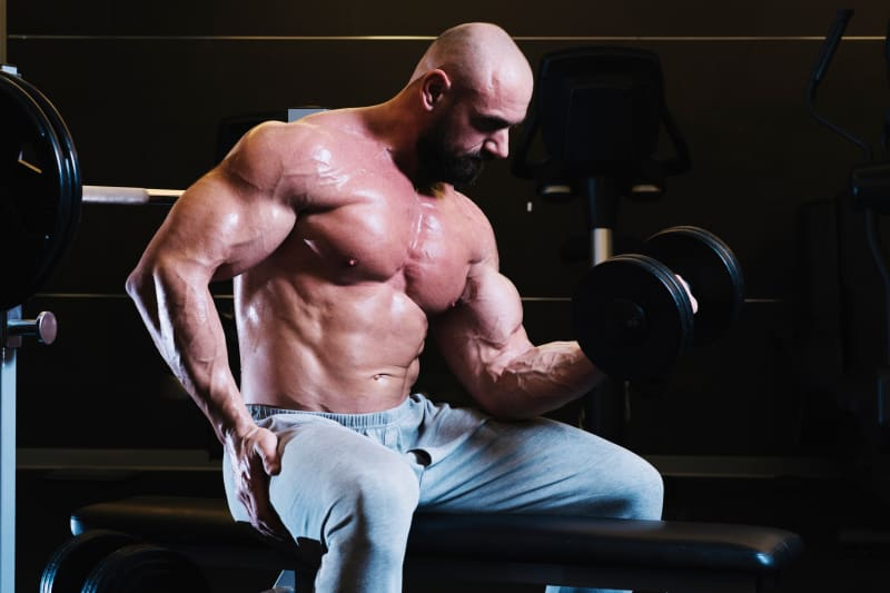 Strong man lifting dumbbell